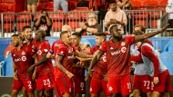 Toronto FC forward Jozy Altidore (17) and teamates celebrate after scoring during second half MLS soccer action against Orlando City, in Toronto, Saturday, July 17, 2021. THE CANADIAN PRESS/Chris Katsarov
