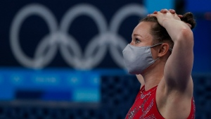Canada's Rosie MacLennan tears up as she watches the results following a fourth place finish in the women's trampoline gymnastics final during the Tokyo Summer Olympic Games, in Tokyo, Friday, July 30, 2021. THE CANADIAN PRESS/Nathan Denette