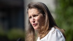 Chrystia Freeland, Deputy Prime Minister and Minister of Finance, responds to questions after a social housing funding announcement in the Downtown Eastside of Vancouver, on Wednesday, July 28, 2021. THE CANADIAN PRESS/Darryl Dyck