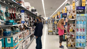 Consumers shop as they wear a mask at a Walmart store in Vernon Hills, Ill., Sunday, May 23, 2021. (AP Photo/Nam Y. Huh)