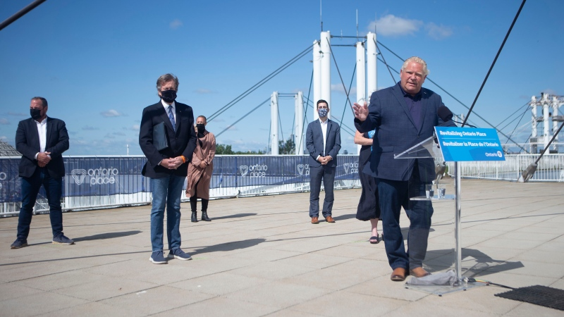 Ontario Premier Doug Ford stands at the podium as he makes an announcement at Toronto's Ontario Place, on Friday July 30, 2021. Ford announced that three companies; Live Nation, Therme Group and Ecorecreo Group, have been selected to redevelop the Ontario Place theme park on Toronto's waterfront, with plans for year-round attractions including a larger concert venue, pools, gardens and an adventure park. THE CANADIAN PRESS/Chris Young