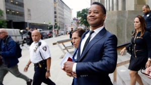 """In this June 13, 2019 file photo, Cuba Gooding Jr. leaves criminal court in New York. U.S. District Judge Paul Crotty issued a default judgment against Gooding on Thursday, July 29, 2021, saying it appeared the Oscar-winning """"Jerry Maguire"""" star was willfully ignoring the lawsuit and that waiting for him any longer would be unfair to his accuser. Crotty said that under the law, the 53-year-old Gooding's failure to respond and defend himself in the lawsuit constituted an admission of liability. (AP Photo/Frank Franklin II, File)"""