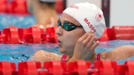 Kylie Masse of Canada rests after her heat in the women's 100-meter backstroke at the 2020 Summer Olympics, Sunday, July 25, 2021, in Tokyo, Japan. (AP Photo/Martin Meissner)
