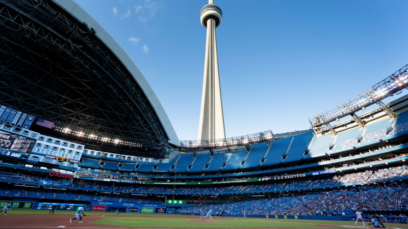 Toronto Blue Jays starting pitcher Ross Stripling (48) throws the opening pitch of the Toronto Blue Jays first home game of the 2021 season at the Rogers Centre in Toronto against the Kansas City Royals during MLB action on Friday, July 30, 2021. THE CANADIAN PRESS/Peter Power