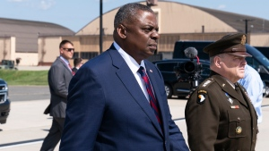Secretary of Defense Lloyd Austin, left, and Joint Chiefs Chairman Gen. Mark Milley walk to greet U.S. Army Gen. Scott Miller, the former top U.S. commander in Afghanistan, upon his return Wednesday, July 14, 2021, at Andrews Air Force Base, Md. (AP Photo/Alex Brandon, Pool)
