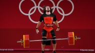 Boady Santavy of Canada reacts after lifting 208kg as he competes in the Men's 96kg Weightlifting finals during the Tokyo Summer Olympic Games, in Tokyo on Saturday, July 31, 2021. THE CANADIAN PRESS/Nathan Denette