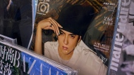A fashion magazine showing Chinese-Canadian singer Kris Wu, centre, on display for sale on a bookshelves at a convenience store in Beijing, Tuesday, July 20, 2021. (AP Photo/Andy Wong)