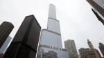FILE - This Thursday, March 10, 2016 file photo shows the Trump International Hotel and Tower in Chicago. An Illinois tax agency has ruled that former President Donald Trump is due a $1 million refund on the 2011 tax bill on his downtown Chicago skyscraper, but local officials are trying to block the refund. (AP Photo/Charles Rex Arbogast, File)