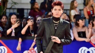 Kris Wu arrives on the red carpet at the iHeartRadio MMVAs in Toronto on Sunday, Aug. 26, 2018. THE CANADIAN PRESS/Frank Gunn