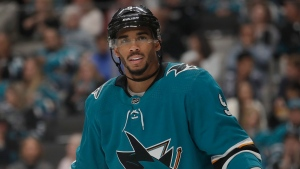 File - In this Oct. 13, 2019, file photo, San Jose Sharks left wing Evander Kane against the Calgary Flames during an NHL hockey game in San Jose, Calif. (AP Photo/Jeff Chiu, File)
