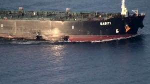 """In this photo taken on Sunday, Oct. 13, 2019, and released by the official news agency of the Iranian Oil Ministry, SHANA, show the scene of damage caused by two missiles that allegedly struck the Iranian oil tanker Sabiti, at the Red Sea. Iran's President Hassan Rouhani warned Sunday it would be """"a big mistake"""" to think his country won't respond to threats after a mysterious attack on one of its oil tankers. (SHANA via AP)"""