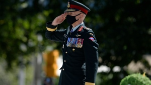 Lt.-Gen Wayne Eyre salutes after laying a wreath during a ceremony marking the 75th anniversary of V-J Day and the end of the Second World War, at the National War Memorial in Ottawa, on Saturday, Aug. 15, 2020. THE CANADIAN PRESS/Justin Tang