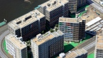 This aerial photo shows the Olympic Village in Tokyo, Sunday, July 18, 2021. (Kyodo News via AP)