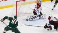Colorado Avalanche goalie Jonathan Bernier and Andrei Mironov, right, team up too stop a shot by against the Minnesota Wild' Brennan Menell, left, during the third period of a NHL preseason hockey game, Saturday, Sept. 23, 2017, in St. Paul, Minn. The Wild won 2-1. (AP Photo/Jim Mone)