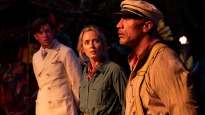"""FILE - This file image provided by Disney shows, from left, Jack Whitehall, Emily Blunt and Dwayne Johnson in a scene from """"Jungle Cruise."""" (Disney via AP, File)"""