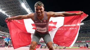Andre De Grasse of Canada reacts after winning the bronze medal in the Men's 100m final during the summer Tokyo Olympics in Tokyo, Japan on Sunday, August 1, 2021. THE CANADIAN PRESS/Frank Gunn