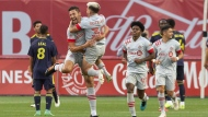 Toronto FC's Omar Gonzalez (centre left) celebrates with Yeferson Soteldo after scoring the game's opening goal during first half MLS action against Nashville SC, in Toronto on Sunday, August 1, 2021. THE CANADIAN PRESS/Chris Young
