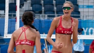 Canada's Sarah Pavan and Melissa Humana-Paredes celebrate a point during round of 16 women's beach volleyball action against Spain at the Tokyo Olympics, Monday, August 2, 2021 in Tokyo, Japan. THE CANADIAN PRESS/Adrian Wyld