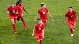 Canada's Jessie Fleming, 17, celebrates scoring the opening goal from the penalty spot during a women's semifinal soccer match against United States at the 2020 Summer Olympics, Monday, Aug. 2, 2021, in Kashima, Japan. (AP Photo/Martin Mejia)