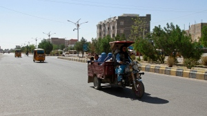 Afghans travel in motorcycle carts during fighting between Taliban and Afghan security forces in Herat province, west of Kabul, Afghanistan, Sunday, Aug. 1, 2021. (AP Photo/Hamed Sarfarazi)