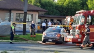 Firefighters and police are seen at the Roycroft Motel on Aug. 2, 2021 after a fatal fire. (Wendy Carrick)