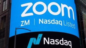 FILE - This April 18, 2019, file photo shows a sign for Zoom Video Communications ahead of their Nasdaq IPO in New York. Zoom has agreed to pay $85 million, Monday, Aug. 2, 2021, to settle a lawsuit alleging allegations its videoconferencing service's weak privacy controls opened too many peepholes into its users' personal information and made it too easy to disrupt their meetings during the early stages of the pandemic. (AP Photo/Mark Lennihan, File)