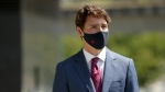 Prime Minister Justin Trudeau looks on after answering questions from reporters following a transit announcement during a press conference at Surrey City Hall in Surrey, B.C., on Friday, July 9, 202. THE CANADIAN PRESS/Chad Hipolito