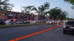 Police tape blocks traffic at the scene of a shooting in Montreal's Riviere-des-Prairies borough on Monday, Aug. 2, 2021. (Image courtesy of Antoinette Delli Compagni)