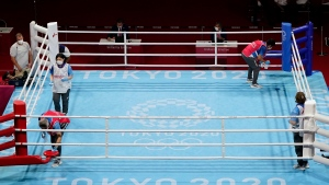 Crews clean and sanitize the ring between boxing matches at the 2020 Summer Olympics, Sunday, July 25, 2021, in Tokyo, Japan. (AP Photo/ Frank Franklin II )