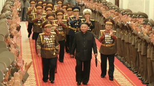 In this photo provided by the North Korean government, North Korean leader Kim Jong Un, center, is applauded by military commanders in Pyongyang, North Korea, on July 24, 2021. North Korea said Friday, July 30, 2021 that Kim called for stronger capability to cope with any foreign provocation as he met with military officers ahead of annual drills next month between South Korea and the United States that Pyongyang views as an invasion rehearsal. Independent journalists were not given access to cover the event depicted in this image distributed by the North Korean government. The content of this image is as provided and cannot be independently verified. (Korean Central News Agency/Korea News Service via AP)
