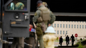 Armored police are seen outside the Pentagon, Tuesday, Aug. 3, 2021 at the Pentagon in Washington. (AP Photo/Andrew Harnik)