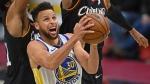 In this April 15, 2021, file photo, Golden State Warriors' Stephen Curry (30) goes to the basket against Cleveland Cavaliers' Jarrett Allen (31) and Isaac Okoro during the second half of an NBA basketball game in Cleveland.  (AP Photo/David Dermer, File)
