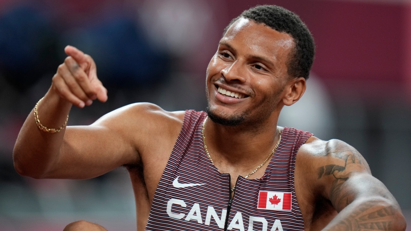 Andre De Grasse, of Canada, reacts after his semifinal of the men's 200-meters at the 2020 Summer Olympics, Tuesday, Aug. 3, 2021, in Tokyo. (AP Photo/Petr David Josek)