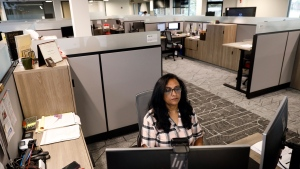 Shobha Surya, associate manager for projects and sales operations of Ajinomoto, a global food and pharmaceutical company, works in a shared office space in Itasca, Ill., Monday, June 7, 2021. (AP Photo/Shafkat Anowar)