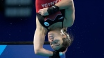 Meaghan Benfeito of Canada competes in women's diving 10m platform preliminary at the Tokyo Aquatics Centre at the 2020 Summer Olympics, Wednesday, Aug. 4, 2021, in Tokyo, Japan. (AP Photo/Dmitri Lovetsky)