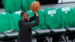 Boston Celtics' Kemba Walker warms up before Game 3 of the team's NBA basketball first-round playoff series against the Brooklyn Nets, Friday, May 28, 2021, in Boston. (AP Photo/Elise Amendola)