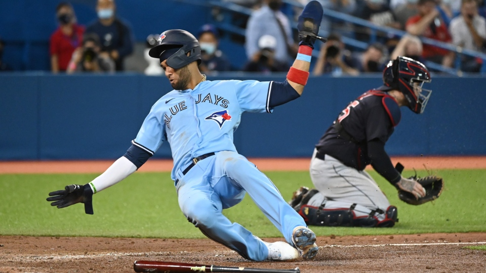 Toronto Blue Jays' Lourdes Gurriel Jr. slides home to score during sixth inning AL baseball action against the Cleveland Indians in Toronto on Tuesday August 3, 2021. THE CANADIAN PRESS/Jon Blacker