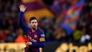"""FILE - In this Saturday, April 6, 2019 file photo, Barcelona forward Lionel Messi waves at the crowd as he holds the trophy of the best Spanish La Liga player prior to a soccer match between FC Barcelona and Atletico Madrid at the Camp Nou stadium in Barcelona, Spain. Barcelona says Lionel Messi will not stay with the club, it was reported on Aug. 5, 2021 in a statement that a deal between the club and the player had been reached but financial """"obstacles"""" made it impossible for the player to remain with the club. (AP Photo/Manu Fernandez, File)"""