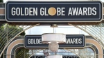 FILE - Event signage appears above the red carpet at the 77th annual Golden Globe Awards, on Jan. 5, 2020, in Beverly Hills, Calif. The Hollywood Foreign Press Association on Thursday announced reforms to its bylaws and an overhaul of its membership process in a bid to diversify its ranks and potentially restore the heavily criticized Golden Globes. (Photo by Jordan Strauss/Invision/AP, File)