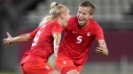 Canada's Adriana Leon, left, celebrates with teammate Quinn after scoring her side's opening goal against Great Britain during a women's soccer match at the 2020 Summer Olympics, Tuesday, July 27, 2021, in Kashima, Japan. (AP Photo/Fernando Vergara)