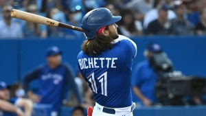 Toronto Blue Jays shortstop Bo Bichette (11) watches his two run home run which scored teammate Vladimir Guerrero Jr. during fourth inning AL baseball game action against the Cleveland Indians in Toronto on Thursday Aug. 5, 2021. THE CANADIAN PRESS/Jon Blacker