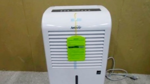 This photo provided by Consumer Product Safety Commission shows a dehumidifier made by New Widetech. The Consumer Product Safety Commission says, Friday, Aug. 6, 2021, about 2 million dehumidifiers made by New Widetech are being recalled in the U.S. because they can overheat and catch fire, posing fire and burn hazards. New Widetech is aware of 107 incidents of the recalled dehumidifiers overheating and/or catching fire, resulting in about $17 million in property damage. No injuries have been reported. (Consumer Product Safety Commission via AP)