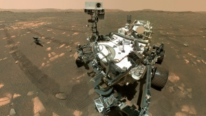 FILE - This Tuesday, April 6, 2021 image made available by NASA shows the Perseverance Mars rover, foreground, and the Ingenuity helicopter about 13 feet (3.9 meters) behind. This composite image was made by the WASTON camera on the rover's robotic arm on the 46th Martian day, or sol, of the mission. On Friday, Aug. 6, 2021, NASA's newest Mars rover came up empty in its first attempt to pick up a rock sample to eventually be brought back to Earth. (NASA/JPL-Caltech/MSSS via AP)