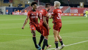 Toronto FC's Ralph Priso (97), Alejandro Pozuelo (10) and Yeferson Soteldo (30) celebrate after Pozuelo scored to tie against New York City during second half MLS soccer action in Toronto on Saturday, August 7, 2021. Second-half goals by Richie Laryea and Alejandro Pozuelo lifted Toronto FC into a wild 2-2 tie with New York City FC in MLS play Saturday. THE CANADIAN PRESS/Chris Katsarov