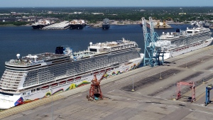 In this May 4, 2020 file photo, Norwegian cruise ships are docked at Portsmouth Marine Terminal in Portsmouth, Va.  Norwegian Cruise Line asked a federal judge Friday, Aug. 6, 2021, to block a Florida law prohibiting cruise companies from demanding that passengers show written proof of coronavirus vaccination before they board a ship. (Stephen M. Katz/The Virginian-Pilot via AP, File)