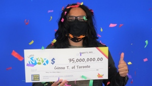 Twenty-nine year-old Ginno Torres collects his $35-million Lotto Max cheque today, after purchasing the jackpot winning ticket on June 22.