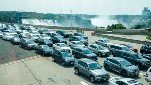 Cars wait on the Rainbow Bridge before crossing the border into Canada, in Niagara Falls, Ont. on Monday, August 9, 2021.THE CANADIAN PRESS/Eduardo Lima