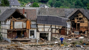 This Thursday, July 15, 2021 file photo shows destroyed houses in Schuld, Germany. Due to heavy rains, the Ahr River dramatically flooded over its banks the previous evening. (AP Photo/Michael Probst)