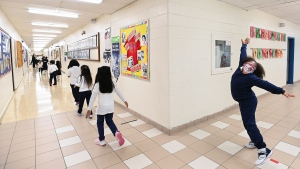 Children walk back to their classroom while physical distancing after getting their pictures taken at picture day at St. Barnabas Catholic School during the COVID-19 pandemic in Scarborough, Ont., on Tuesday, October 27, 2020. THE CANADIAN PRESS/Nathan Denette