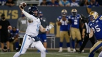 Toronto Argonauts quarterback Nick Arbuckle (9) throws against the Winnipeg Blue Bombers during the second half of CFL action in Winnipeg Friday, August 13, 2021. THE CANADIAN PRESS/John Woods